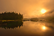 Prudhomme Lake reflection in fog at sunrise, Prudhomme Lake Provincial Park , British Columbia, Canada