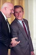 Former pro wrestler and Governor of Minnesota, Jesse Ventura (L) with Texas Governor George W. Bush at the National Governor's Association meeting being February 22, 1999 in Washington, DC.