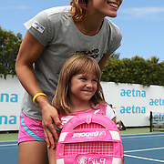August 16, 2014, New Haven, CT:<br /> Andrea Petkovic poses for a photograph with a young fan during a tennis clinic in the AETNA FitZone as part of Kids Day on day three of the 2014 Connecticut Open at the Yale University Tennis Center in New Haven, Connecticut Sunday, August 17, 2014.<br /> (Photo by Billie Weiss/Connecticut Open)