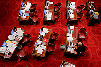Senator Dave Cox, R-Fair Oaks, sits on the floor alone during a Senate recess. The Senate is waiting to take up the budget plan today.