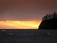 crepuscular rays at sunset Teahwhit Head at Third Beach on the Olympic Paninsula, Olympic National Park, Washington, USA
