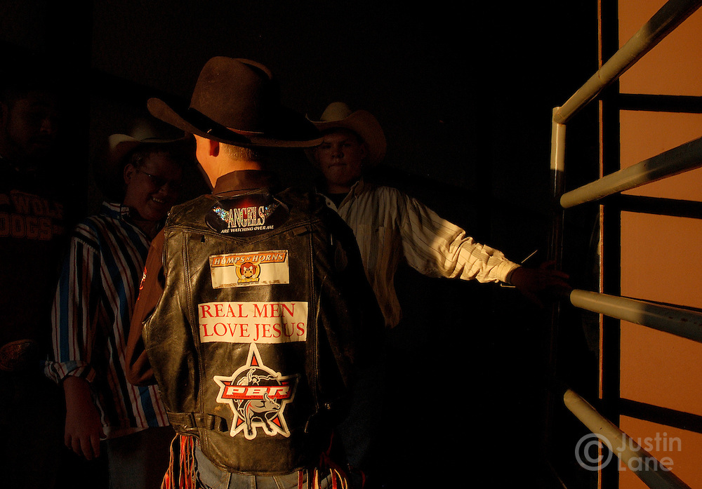 A young bull rider is seen with a Jesus sticker on his vest during a rodeo at the Cowboy Church in Amarillo, TX that holds a Christian rodeo each Thursday in their own arena behind the church, Thursday July 14, 2005. The church rodeo, in which semi-professional bull riders compete, is designed to bring in people who are interested in the sport then expose them to the teachings of Jesus.