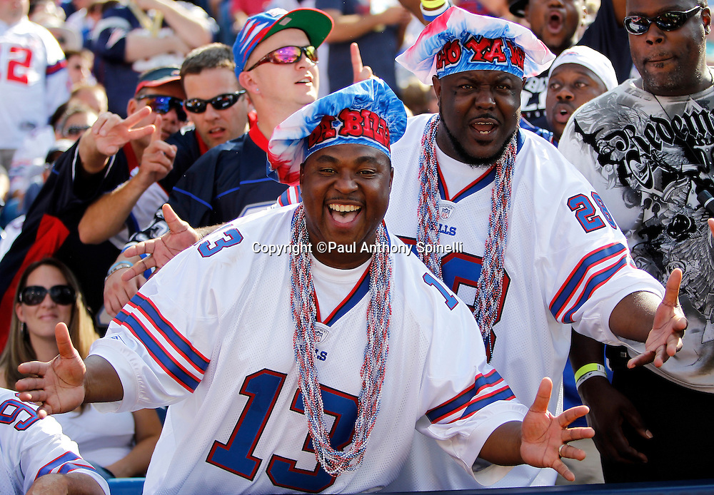 Two Buffalo Bills fans wearing chef hats cheer during the NFL week 3 football game against the New England Patriots on Sunday, September 25, 2011 in Orchard Park, New York. The Bills won the game 34-31. ©Paul Anthony Spinelli