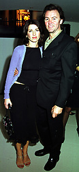 Singer PAUL YOUNG and his wife STACEY YOUNG, at a party in London on 12th October 1999.MXM 115