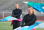 """Color guard member Mindy Salzbrenner keeps her eyes on the drum major during the Mount Vernon High School Marching Band performance at the State Marching Band Festival at Kingston Stadium in Cedar Rapids on Saturday October 6, 2012. Their program included """"You Can Call Me Al"""", """"Smells Like Teen Spirit"""", """"Clocks"""", and """"The Edge of Glory""""."""