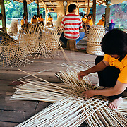 Local tribes people build baskets at the Chiang Dao Cave in the jungle near Chiang Dao, Thailand.