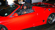 Wyclef Jean on his Ferrari after having dinner<br />