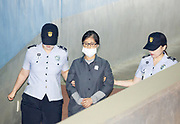 Choi Soon-Sil (C), a longtime friend of former South Korean President Park Geun-hye, arrives at the Seoul Central District Court from a prison before Park's trial in Seoul, South Korea, August 4, 2017. Choi stood accused of influence-peddling. Photo by Lee Jae-Won (SOUTH KOREA) www.leejaewonpix.com