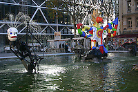 colourful moving sculptures and fountains by Jean Tinguely and Niki de St-Phalle in pool beside Place Igor<br />