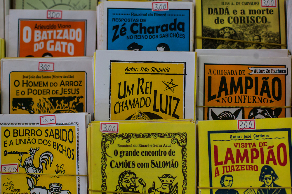 """Fortaleza_CE, Brasil.<br /> <br /> Literatura de Cordel em Fortaleza, Ceara.<br /> <br /> Cordel literature (Portuguese for """"string literature"""") are popular and inexpensively printed booklets or pamphlets containing folk novels, poems and songs, which are produced and sold in fairs and by sidestreet vendors in the northeast of Brazil.<br /> <br /> Foto: RODRIGO LIMA / NITRO"""