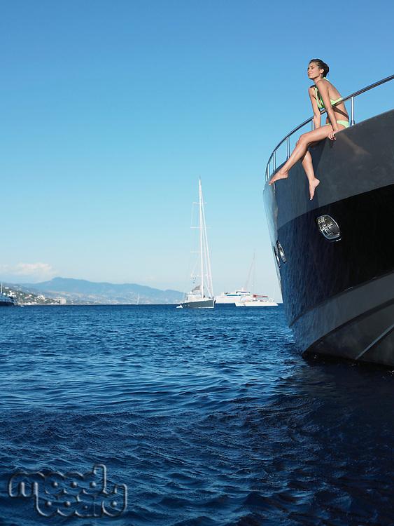 Woman Sitting on Yacht