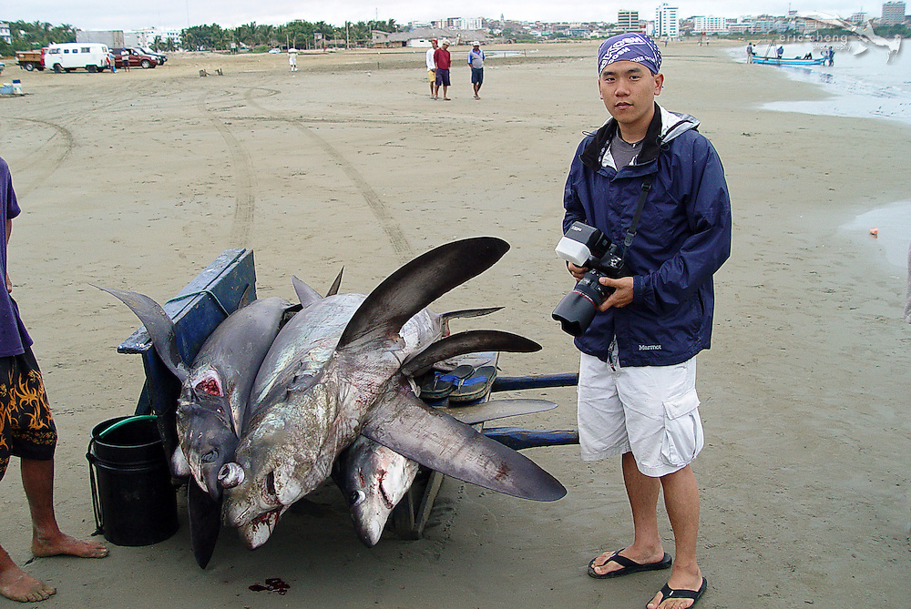 Eric Cheng in Manta, Ecuador, photographing shark fishing