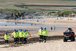 © Licensed to London News Pictures. 31/05/2020. Padstow, UK. RNLI Lifeguards, coastguards and paramedics attend an incident on Constantine beach on the north coast of Cornwall this afternoon. Yesterday the RNLI reinstated their beach lifeguard service, having not provided the usual lifeguard service for this time of year in Cornwall, due to Coronavirus (COVID-19). Photo credit : Tom Nicholson/LNP
