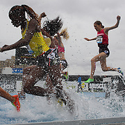 Action at the water jump during the Women's 3000m Steeplechase race won by Lidya Chepkurui, Kenya, at the Diamond League Adidas Grand Prix at Icahn Stadium, Randall's Island, Manhattan, New York, USA. 25th May 2013. Photo Tim Clayton