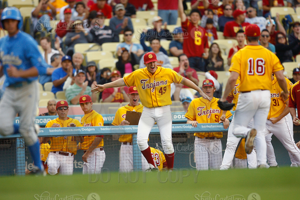 13 March 2011: NCAA Pac-10 college UCLA-USC sports rivalry baseball teams met in a non-conference game at Dodger Stadium as part of the Dodgertown Classic.  USC Trojans defeated the UCLA Bruins 2-0 during an afternoon weekend game inside the MLB stadium.  #49 Brad Douthit reacts after a winning inning.