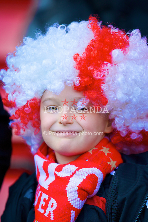 LIVERPOOL, ENGLAND - Saturday, February 16, 2008: A young Liverpool supporter wearing a red and white wig during the FA Cup 5th Round match against Barnsley at Anfield. (Photo by David Rawcliffe/Propaganda)