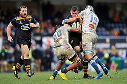 Tom Lindsay of Wasps is double-tackled by Mathieu Babillot and William Whetton of Castres Olympique - Photo mandatory by-line: Patrick Khachfe/JMP - Mobile: 07966 386802 14/12/2014 - SPORT - RUGBY UNION - High Wycombe - Adams Park - Wasps v Castres Olympique - European Rugby Champions Cup