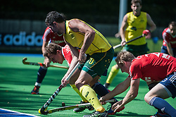 Australia's Russell Ford is challenged by Tom Carson and Tim  Whiteman of England. England v Australia, Bisham Abbey, Marlow, UK on 25 May 2014. Photo: Simon Parker