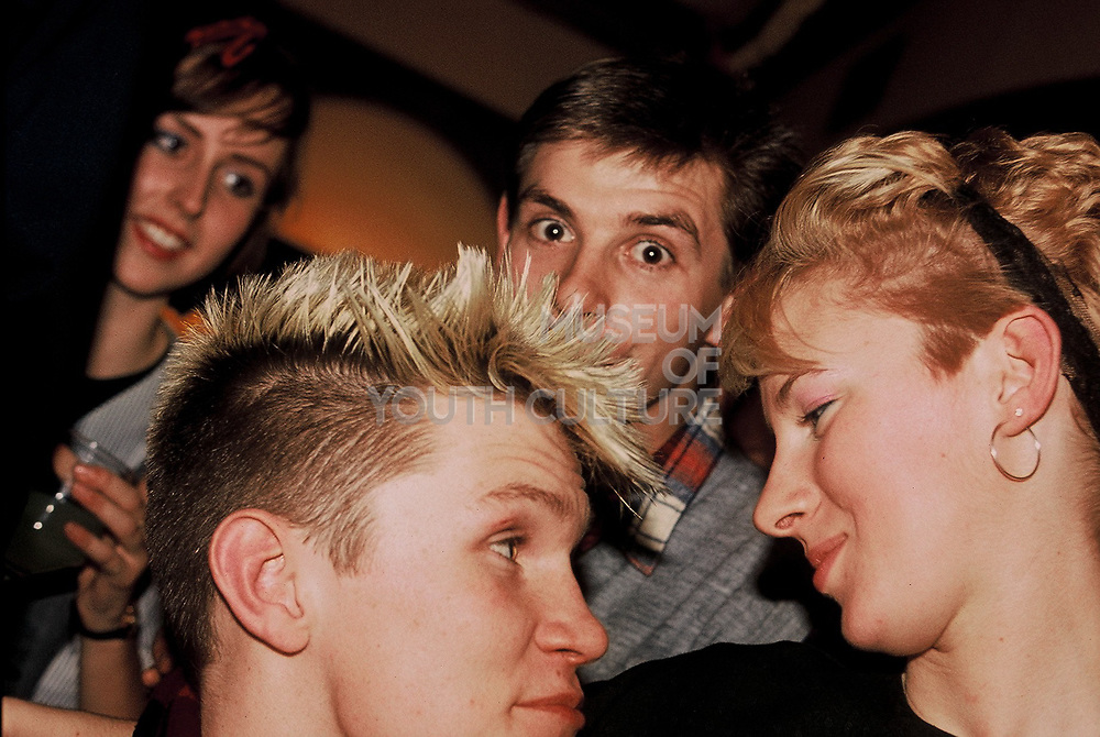 Teenagers in the pub on Christmas Eve, London, UK, 1983