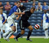 Photo: Paul Thomas.<br /> Blackburn Rovers v Chelsea. The Barclays Premiership. 27/08/2006.<br /> <br /> Brett Emerton (L) of Blackburn battles with Andriy Shevchenko for the ball.