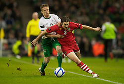 DUBLIN, IRELAND - Tuesday, February 8, 2011: Wales' Sam Ricketts and the Republic of Ireland's Damien Duff during the opening Carling Nations Cup match at the Aviva Stadium (Lansdowne Road). (Photo by David Rawcliffe/Propaganda)
