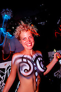 Working topless with just body paint at a South Beach club named Groove Jet is waitress Anne Wiklund in May 1999 , during South Beach's peak. She signed a photo release permitting publication of this photo for editorial and documentary uses.<br />