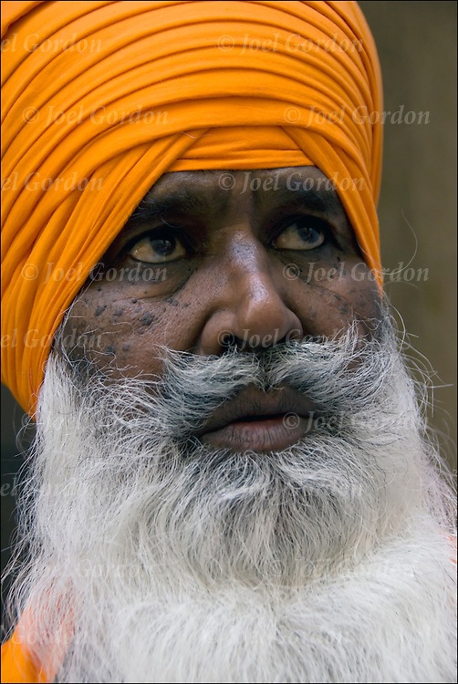 "Portrait of Sikh 70 year old male showing his ethnic pride. Man with turban usually means he's a Sikh. Religion is called Sikhism, come from the state of Punjab in India, believe in one g-d and do not worship idols, fifth largest monotheistic religion. call g-d ""Wahegura"" meaning ""the supreme teacher"" never cut their hair, believe that men and women are born equal, in monogamy and reincarnation."