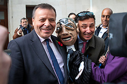 © Licensed to London News Pictures. 04/11/2018. London, UK. Co-founder of the Leave.EU campaign Arron Banks (L) and Andy Wigmore (R) poses with a puppet of Nigel Farage brought by anti-Brexit protesters as they leave BBC Broadcasting House. Photo credit: Rob Pinney/LNP