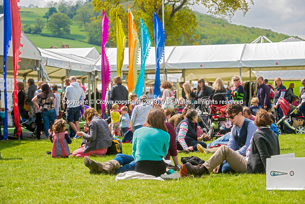People sitting reading at festival site<br /> Hay Literary Festival 2013<br /> Hay-on-Wye<br /> Powys<br /> South<br /> Culture<br /> Arts<br /> Events