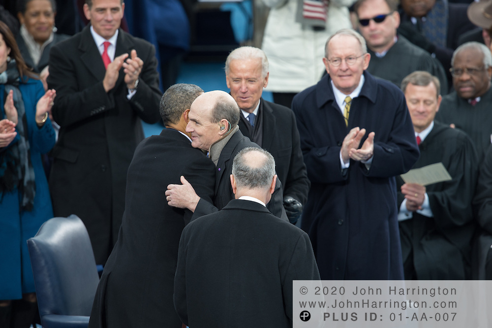 President Obama congratulates James Taylor after her performs at the 57th Presidential Inauguration of President Barack Obama at the U.S. Capitol Building in Washington, DC January 21, 2013.