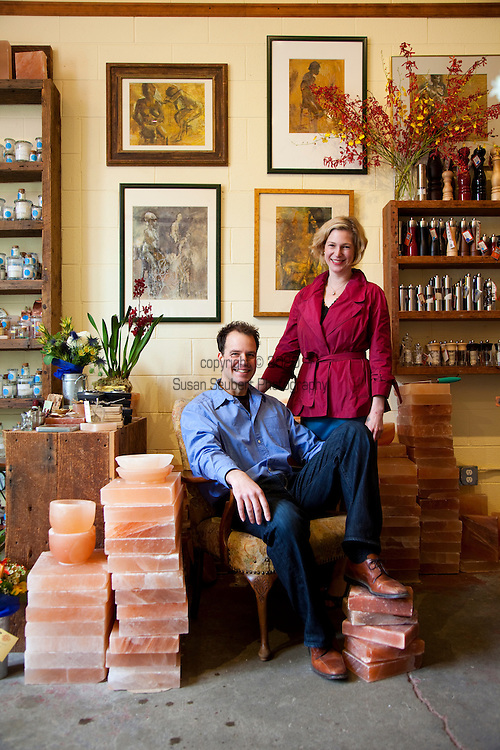 Mark and Jennifer Bitterman, owners of The Meadow, a salt shop in the North Mississippi neighborhood of Portland, Oregon, surrounded by blocks of pink Himalyan salt which are used for cooking and serving food.