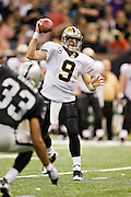 NEW ORLEANS, LA - OCTOBER 12:   Drew Brees #9 of the New Orleans Saints fakes a pass against the Oakland Raiders at the Louisiana Superdome on October 12, 2008 in New Orleans, Louisiana.  The Saints defeated the Raiders 34-3.  (Photo by Wesley Hitt/Getty Images) *** Local Caption *** Drew Brees