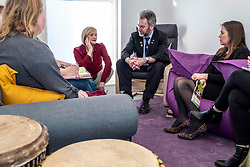 Pictured: Aileen Campbell and Councillor Steven Heddle (representing COSLA) met with youth workers in the quiet room<br />