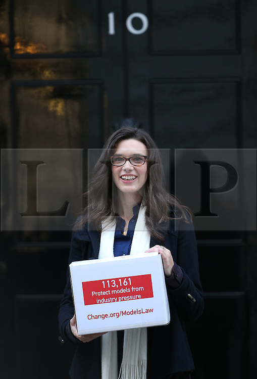 © Licensed to London News Pictures. 01/12/2015. London, UK. Model Rosie Nelson poses in Downing Street. Rosie is presenting a petition for a law that would protect young models from being pressurised into becoming dangerously thin. Photo credit: Peter Macdiarmid/LNP