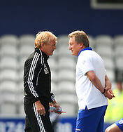 Loftus Road, London - Saturday 11th September 2010: Gordon Strachan, manager of Middlesborough and Neil Warnock, manager of QPR look on during the Npower Championship match between Queens Park Rangers and Middlesborough. (Photo by Andrew Tobin/Focus Images)