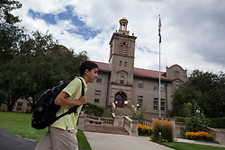 """Santiago Gonzalez, 13, heads to class at the Colorado School of Mines, an engineering university where he is a full-time student in Littleton, Colo., Aug. 29, 2011. Gonzalez wakes up at 5:30 a.m. every morning during the academic semester to develop iPad and iPhone applications in a programming language called Objective C, which he learned from a textbook when he was 9 years old. That textbook and 86 similar volumes including Applied Finite Mathematics, Infinity in Your Pocket, Programming in C++ and Dictionary of Physics, sit in a glass-fronted bookcase opposite his bed. """"Exceptionally gifted"""" is the commonly used phrase for kids as smart as Gonzalez."""