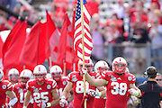 Nebraska Cornhuskers running back Graham Stoddard (38) carries the US Flag as the Cornhuskers take the field prior to the Georgia Bulldogs 45-31 win in the Capital One Bowl at the Florida Citrus Bowl on Jan 1, 2013 in Orlando, Florida. ..©2012 Scott A. Miller..