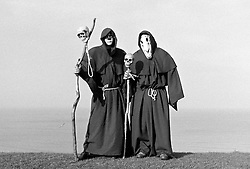 © Licensed to London News Pictures.01/11/15<br /> Whitby, UK. <br /> <br /> Two men dressed as skeletal monks pose for a picture as they attend the Whitby Goth weekend in Whitby, North Yorkshire. The event began in 1994 to celebrate goth culture and music and takes place twice each year. <br /> Thousands of extravagantly dressed people attend the popular event wearing Steampunk, Cybergoth, Romanticism, Victoriana and other clothing as they take part in the celebration of Goth culture. <br /> <br /> Note to Editors - Picture shot on Kodak Tri X 400ISO film.<br /> Photo credit : Ian Forsyth/LNP
