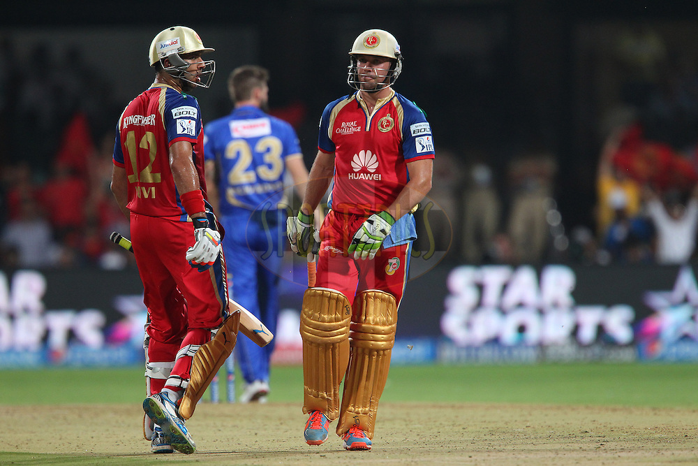 Yuvraj Singh of the Royal Challengers Bangalore and AB de Villiers of the Royal Challengers Bangalore celebrate a four as Kane Richardson of the Rajatshan Royals walks back during match 35 of the Pepsi Indian Premier League Season 2014 between the Royal Challengers Bangalore and the Rajasthan Royals held at the M. Chinnaswamy Stadium, Bangalore, India on the 11th May  2014<br /> <br /> Photo by Ron Gaunt / IPL / SPORTZPICS<br /> <br /> <br /> <br /> Image use subject to terms and conditions which can be found here:  http://sportzpics.photoshelter.com/gallery/Pepsi-IPL-Image-terms-and-conditions/G00004VW1IVJ.gB0/C0000TScjhBM6ikg