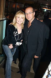 Singer LULU and PAUL MCKENNA at a party to celebrate the publication of Dot.Homme by Jane Moore held at Embassy Club, Old Compton Street, London on 14th July 2004.