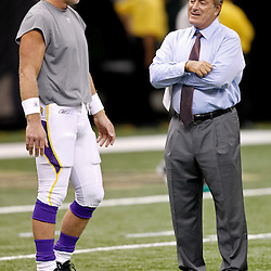 September 9, 2010; New Orleans, LA, USA;  Minnesota Vikings quarterback Brett Favre (4) talks to television announcer Al Michaels during warm ups prior to the NFL Kickoff season opener between the Minnesota Vikings and the New Orleans Saints at the Louisiana Superdome. Mandatory Credit: Derick E. Hingle