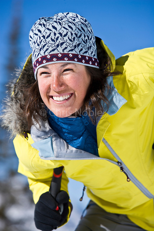 A woman enjoys ski touring in the Wasatch Mountain backcountry near Alta, Utah.