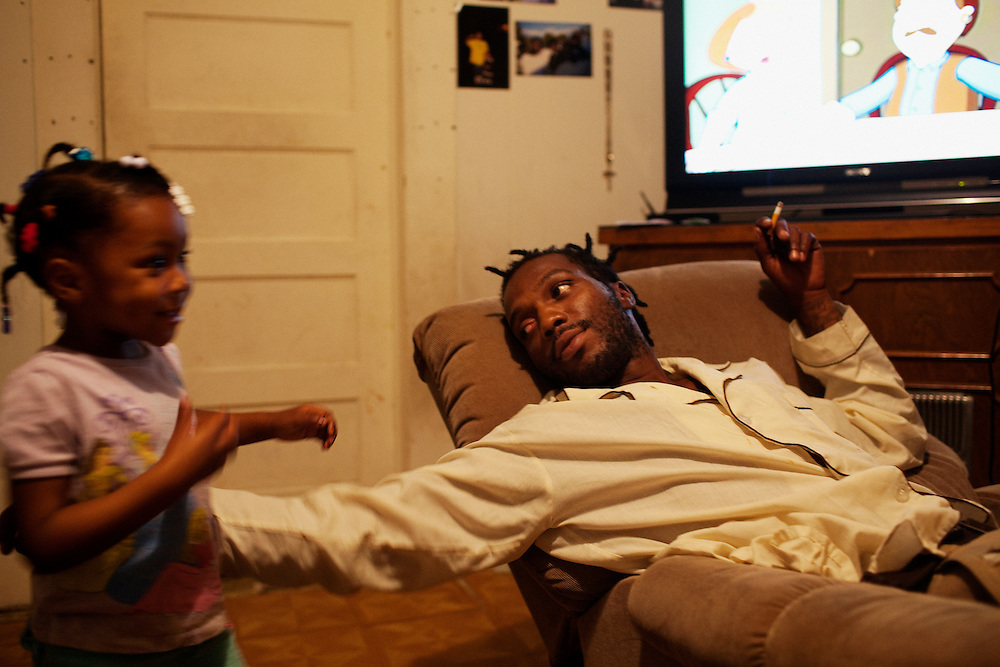 "Roger ""Winky"" Williams in his home after a long day of working in the Baptist Town neighborhood of Greenwood, Mississippi on May 26, 2011."