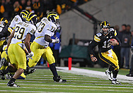 October 10, 2009: Iowa quarterback Ricky Stanzi (12) scrambles with the ball during the first half of the Iowa Hawkeyes' 30-28 win over the Michigan Wolverine's at Kinnick Stadium in Iowa City, Iowa on October 10, 2009.