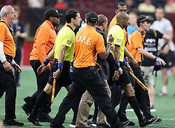 May 9, 2018 - Atlanta, GA, USA - Security guards escort the game officials off the field after a heated match between Atlanta United and Sporting Kansas City on Wednesday, May 9, 2018, in Atlanta. Sporting Kansas City won, 2-0. (Credit Image: © Curtis Compton/TNS via ZUMA Wire)