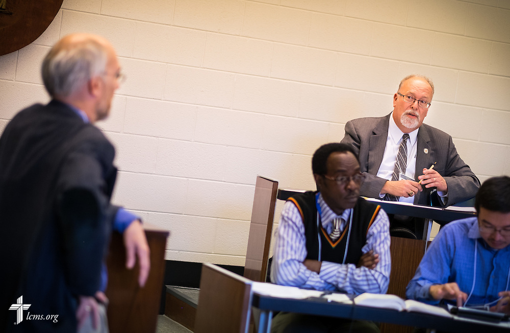 "(From L-R) Dr. Joseph Herl listens to a question from the Rev. Stephen Starke during a lecture at the ""Fresh Hymns of Thankful Praise"" symposium at Concordia Theological Seminary in Fort Wayne, Ind."