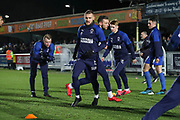 AFC Wimbledon attacker Shane McLoughlin (19) and AFC Wimbledon Jack Rudoni (12) warming up prior to kick off during the EFL Sky Bet League 1 match between AFC Wimbledon and Ipswich Town at the Cherry Red Records Stadium, Kingston, England on 11 February 2020.