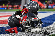 A Tampa Bay helmet and pads lay on the pitchduring the International Series match between Tampa Bay Buccaneers and Carolina Panthers at Tottenham Hotspur Stadium, London, United Kingdom on 13 October 2019.