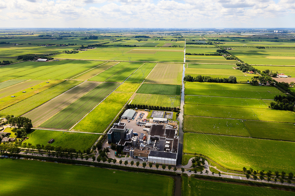 Nederland, Noord-Holland, Beemster, 14-06-2012; De Beemster, 400 jaar 1612 - 2012. Fabriek van CONO Kaasmakers, een cooperatie. De kaasfabriek aan de Rijperweg maakt Beemsterkaas. .CONO cheesemakers, a cooperative. The cheese factory makes Beemster cheese..De 17e eeuwse droogmakerij, met haar  beroemde geometrische verkaveling, maakt deel uit van het wereld erfgoed (Unesco werelderfgoedlijst). The famous geometrical well-ordered polder Beemster, 17th century  reclaimed landscape, Unesco world heritage..luchtfoto (toeslag), aerial photo (additional fee required);.copyright foto/photo Siebe Swart
