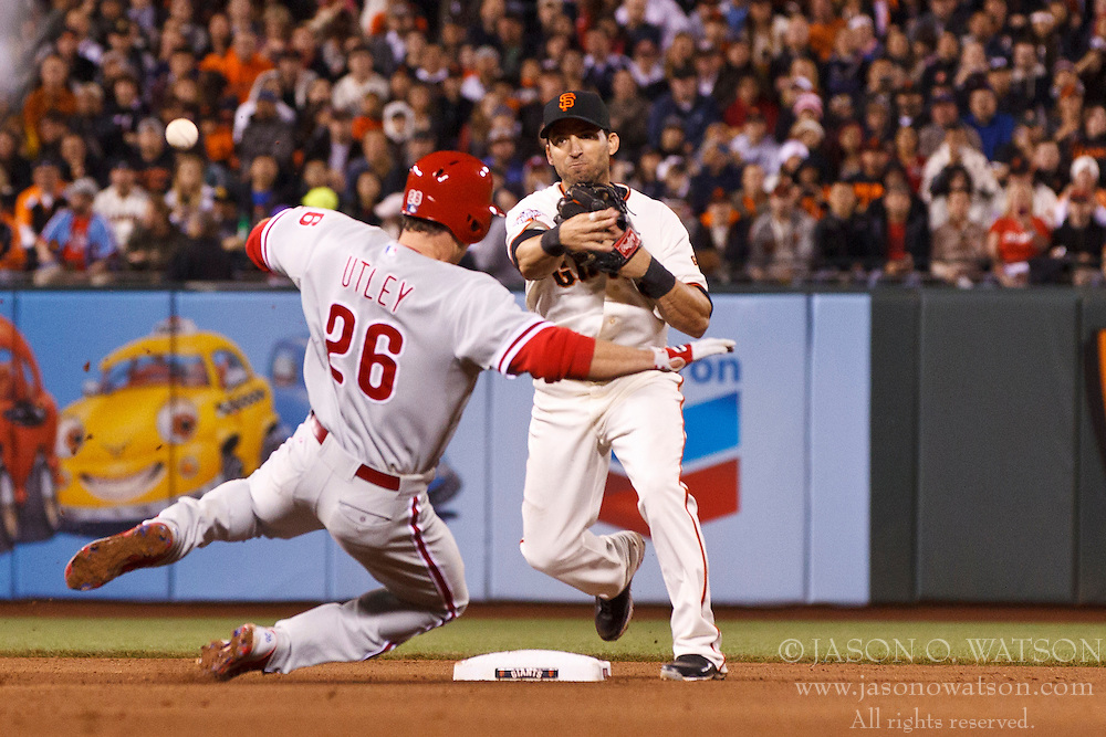SAN FRANCISCO, CA - MAY 06: Marco Scutaro #19 of the San Francisco Giants completes a double play over Chase Utley #26 of the Philadelphia Phillies during the seventh inning at AT&T Park on May 6, 2013 in San Francisco, California. (Photo by Jason O. Watson/Getty Images) *** Local Caption *** Marco Scutaro; Chase Utley